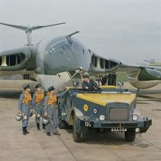 A Handley Page Victor under tow from an RAF towing truck. The flight crew talk to the driver of the truck. Military Jets, Military Veterans, Military Aircraft, Vickers Valiant, Handley Page Victor, V Force, War Jet, Avro Vulcan, British Armed Forces