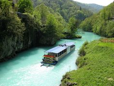 RIVER SOCA near the town of TOLMIN, Slovenia - The pristine beauty of this emerald river attracts nature lovers, photographers and water-sports enthusiasts from all around the world. It is truly is a nature's paradise. Slovenia Travel, Central Europe, Water Sports, Cool Photos, National Parks, Castle, Around The Worlds, Boat, River
