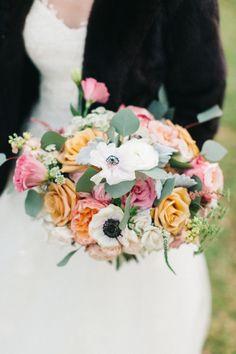 Colorful anemone + rose bouquet: http://www.stylemepretty.com/south-carolina-weddings/edisto/2016/01/11/elegant-timeless-waterside-southern-wedding/ | Photography: Caroline Ro - http://carolinero.com/