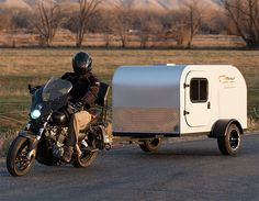 Moby1 Motorcycle Trailer If your days of motorcycle roadtrips with nothing but a bed roll strapped to the bars are now behind you, the Moby 1 might get you back out on the open road. Their lightweight, compact campers weigh less than 300lbs, with a low, teardrop style design that is perfect for pulling behind your bike or sub-compact car. At 80-inches long they've got a bed & storage inside plus a galley in the back. $6500