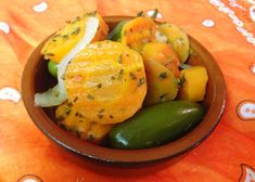 """spicy pickled carrots  1 Tbsp. coconut oil - 1 medium onion, thinly sliced - 5 cloves garlic, crushed - 6 small jalapenos, whole - 2 lbs large carrots, peeled and chopped into 1/4"""" thick pieces - 1 1/2 cups apple cider vinegar - 3 cups water - 2 tsp. sea salt - 1 Tbsp. dried oregano - 10 bay leaves - 10 peppercorns"""