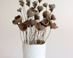 ENJOY MY SPRING FLING and get 10% off this or any item in my shop. Use COUPON CODE: springfling2017 at checkout.  [This listing is for my tall handmade cone vase in BLACK or WHITE with 11 handmade red ceramic flowers. Please choose vase color in drop-down menu before you add to cart.  This special modern home décor bouquet is the perfect touch to any special corner or table in your house that is just waiting for that unique, one of a kind addition.  First, I handmade a vase from white clay…