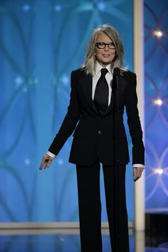 Diane Keaton accepts the Cecil B. DeMille Award for Lifetime Achievement at tonight's Golden Globes on behalf of Woody Allen wearing a Ralph Lauren made-to-measure Spring Collection 2014 suit