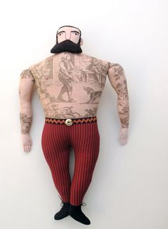 I love these tattooed toile dolls. I've been wanting one for so long now.