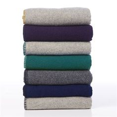 The Soft Wool Edge from Klippans Yllefabrik comes in beautiful colors and a stylish timeless design. The throws suits perfect in bed, on the couch, or to take with you in the car. They are made in very highest quality wool and make you stay warm every day. Combine with other blankets and cushions from Klippans Yllefabrik. In the picture, the throws are stacked i the colors light grey/yellow, plum/black, light grey/petrol, petrol/jade, dark grey/black, navy/black and light grey/black.