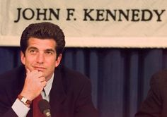 """John F. Kennedy, Jr. listens to a question from the audience during a panel discussion entitled """"The Medicare Debate: Then and Now"""" at Harvard University's John F. Kennedy School of Government in Cambridge, Mass., Thursday afternoon April 29, 1997."""
