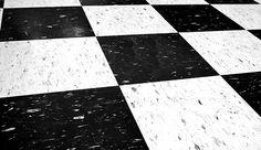 Vinyl composite garage floor tile.  Cool checkered flag theme is very retro!