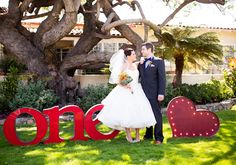 "metallic ""one (heart)"" sign and Designer: Rosa Clara's Erudito wedding dress"