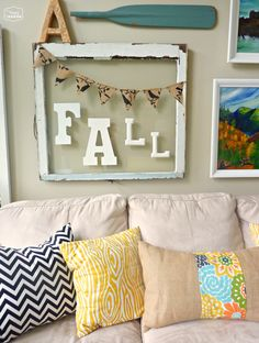 How to make a burlap and fabric strip pillow tutorial for fall decor at thehappyhousie #fall decorating #burlap pillow #burlap and fabric strip pillow #how to sew a burlap envelope pillow #DIY envelope pillow