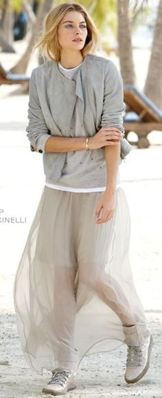 How can you not love Brunello Cucinelli?! This outfit just stands out in every way! Representing some of the boyfriend look (that is very in) with a little bit of elegance! The pieces work soo well together. The sheerness of the skirt brings a feminine feel to the outfit.