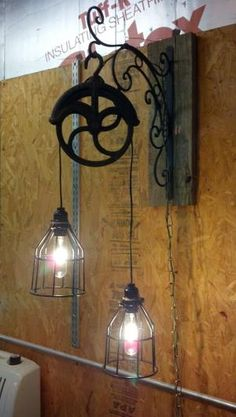 Love this, light fixture made from old pulley - very rustic!
