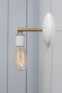 Brass and White Wall Sconce Light