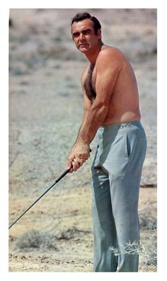 Sean connery hitting a few golf balls in the navada desert on location of diamon. - Sean connery hitting a few golf balls in the navada desert on location of diamonds are fore ever .