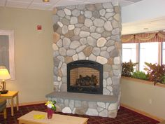 My mamma had a river rock fireplace in our house growing up and I plan on havin one when we build ours!!! Love it
