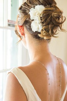 elegant wedding updo #weddinghair #purplewedding #weddingnecklace http://www.weddingchicks.com/2014/01/10/lavender-and-white-wedding/