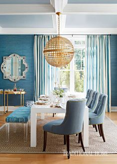 Hampton Designer Showhouse 2015,Traditional Home. Circa Lighting, Aerin pendant, blue linen chairs, vintage Milo Baughman parson table in shades of blue.