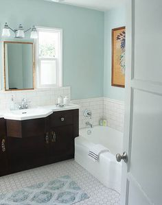 Color combo ... light floors, dark vanity, pale blue walls