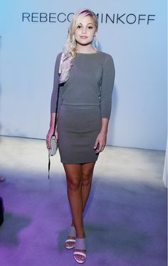 Olivia Holt wears a Rebecca Minkoff gray sweater, matching pencil skirt, mules, and a shoulder bag