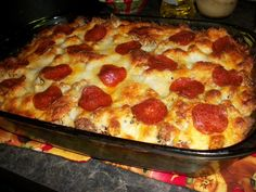 Pizza Spaghetti Casserole !! 1 lb. Ground meat  16 oz. box uncooked spaghetti noodles ½ t salt ½ t Oregano  ½ t garlic powder ½ C Milk  1 Egg 2 oz sliced pepperoni  26 oz jar pasta sauce 16 oz. can diced Italian style tomatoes  ¼ C Parmesan cheese 8 oz package shredded Italian cheese blend Any other pizza toppings you like, black olives, sausage, onions, green peppers, etc...