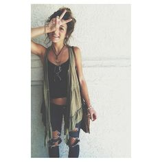 Cool, a little bohemian, simple Ripped jeans, black tank top, breezy sleeveless green cover up, messy bun
