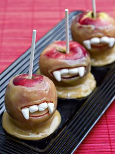 Delicious #Vampire Caramel Apples with a Bite.  Simply dip apples into a yummy caramel concoction, cut a wedge of apple out to make the mouth, and snip marshmallows in half for central teeth and into triangles for fangs.  Use the caramel to stick the teeth to the mouth.  Happy #Halloween!