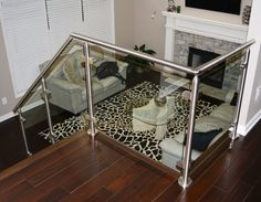 Virginia Round Glass Railing System in a contemporary living space.  cablerailing.com