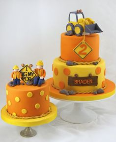 An amazing cake covered in in bright yellow and orange fondant with a couple of cute fondant models. Perfect for that construction party.  #constructionparty #diggerparty
