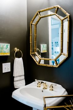 dark gray, charcoal powder room, gold faux bamboo mirror, abstract painting, pedestal sink