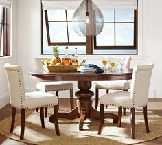 Love the Tivoli Extending Pedestal Dining Table | Pottery Barn with the light overhead