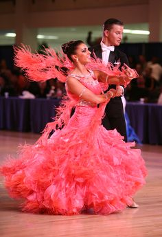 Ballroom Dress by SENA Couture.  I love the ostrich feathers!