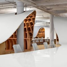 """""""Megalomaniacal ambition"""" inspired the design for this huge, glossy table by Clive Wilkinson, which rises and falls in a loop around a New York office.."""
