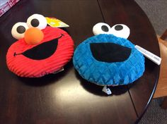 Come to the baby shower to get an Elmo or Cookie Monster Giggle Face