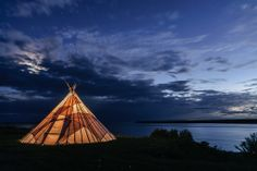 Living a Cree Dream. A Cree miijwaap built along the Rupert River in the Community of Waskaganish, Quebec, Canada.