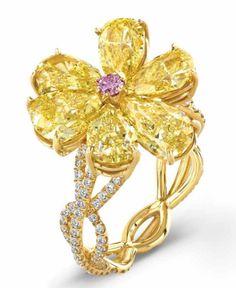 Diamond Ring. White, Fancy Yellow, and Fancy Pink Diamond.