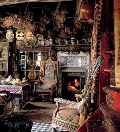 Mad mix of rich pattern and color in this bohemian Gypsy house brimming with antiques, hanging bunches of herbs and soft lighting.