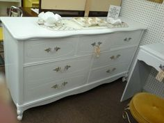 "$199 - This French Provincial style 7 drawer dresser is painted a crisp white with original hardware. Measuring approximately 62"" across the front by 18 1/2"" deep by 33"" Tall. ***** In Booth G14 at Main Street Antique Mall 7260 E Main St (east of Power RD on MAIN STREET) Mesa Az 85207 **** Open 7 days a week 10:00AM-5:30PM **** Call for more information 480 924 1122 **** We Accept cash, debit, VISA, Mastercard, Discover or American Express"