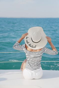 What to wear on a yacht | striped top outfits | do not disturb straw hat | on a boat