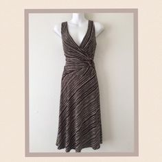 """💕CLEARANCE SALE💕 faux wrap, décolleté neckline 🎉Host Pick🎉 Very flattering style faux wrap style. Cinched at the waist with a ceramic circle it hugs the waist and flatters the figure. It features a décolleté neckline and a bias cut to create a flowing feeling. The fabric is a polyester/spandex blend. Dry clean only. 🔹Measures 16"""" across bust in front from armpit to armpit but could be wider because of the stretch in fabric 🔹length is 42"""" long 🔹hip area is 32"""" but has room with stretch…"""