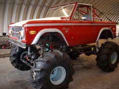 Lifted Red Ford Bronco - jacked and ready to ride
