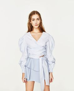 Image 2 of LEATHER-EFFECT MINI SKIRT WITH FRILLS from Zara
