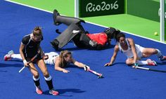 Germany's Charlotte Stapenhorst (L) celebrates after scoring a goal during the women's Bronze medal hockey Germany vs New Zealand match of the Rio 2016 Olympics Games at the Olympic Hockey Centre in Rio de Janeiro on August 19, 2016. / AFP / Pascal GUYOT (Aug. 18, 2016 - Source: AFP)
