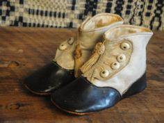 Victorian Baby Shoes  http://www.kittredgemercantile.com/shop/antiques/vintage-victorian-baby-shoes/prod_272.html