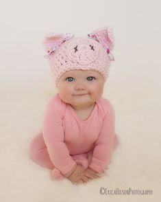 Adorable pig hat, that is custom made especially for you! This hat is made out of a soft, chunky acrylic yarn. It is adorned with floral