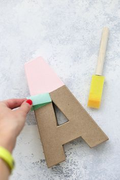 How to Make Colorful Wall Letters - Skip the expensive ones at the store! It's so easy and inexpensive to make your own wall letters! Scrabble Tile Wall Art, Letter Wall Decor, Kids Wall Decor, Diy Wall Art, Wall Letters For Nursery, Playroom Ideas, Decorative Letters For Wall, Playroom Decor, Painted Wood Letters