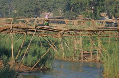A Growing City in Malawi and its Pay-to-Cross Footbridges; Lilongwe River.