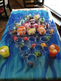 This fun under the sea themed game was found online at a party supply website. It was set up of small fish bowls with tiny fish inside and kids would stand behind a taped line and toss ping pong balls into the fishbowls. rhs