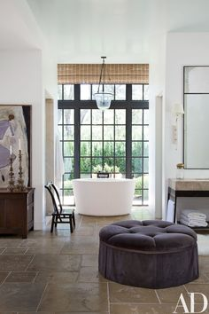 A concrete soaking tub dominates a Napa Valley, California, master bath by architectural firm McAlpine Tankersley and interior designer Rela Gleason; the Summer Hill ottoman is covered in a Suzanne Tucker Home cotton velvet. Architectural Digest, Napa Valley, Next Bathroom, Bathroom Ideas, Bathroom Designs, Gold Bathroom, Bathroom Layout, Bathroom Faucets, Bathroom Furniture
