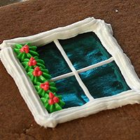 Gingerbread House Baking and Decorating Tutorial.  I love the idea of pouring the molten sugar into cookie cutters for decoration!