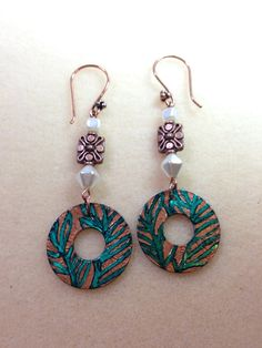 Earring Challenge Sunday. Etched earrings colored with copper Swellegant and teal alcohol ink, acrylic pearls and copper spacers. Design by Renie Hoffman of Heart's Dezire.