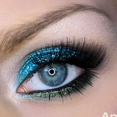 Use vibrant eyeshadow bases and top it with glitter to get this eye-catching eye makeup. Finish it with long false lashes for stunning eyes perfect for night out. See the complete product list to DIY.